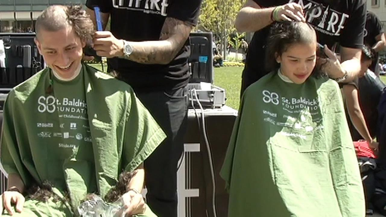 2 University of San Francisco students have their head shaved