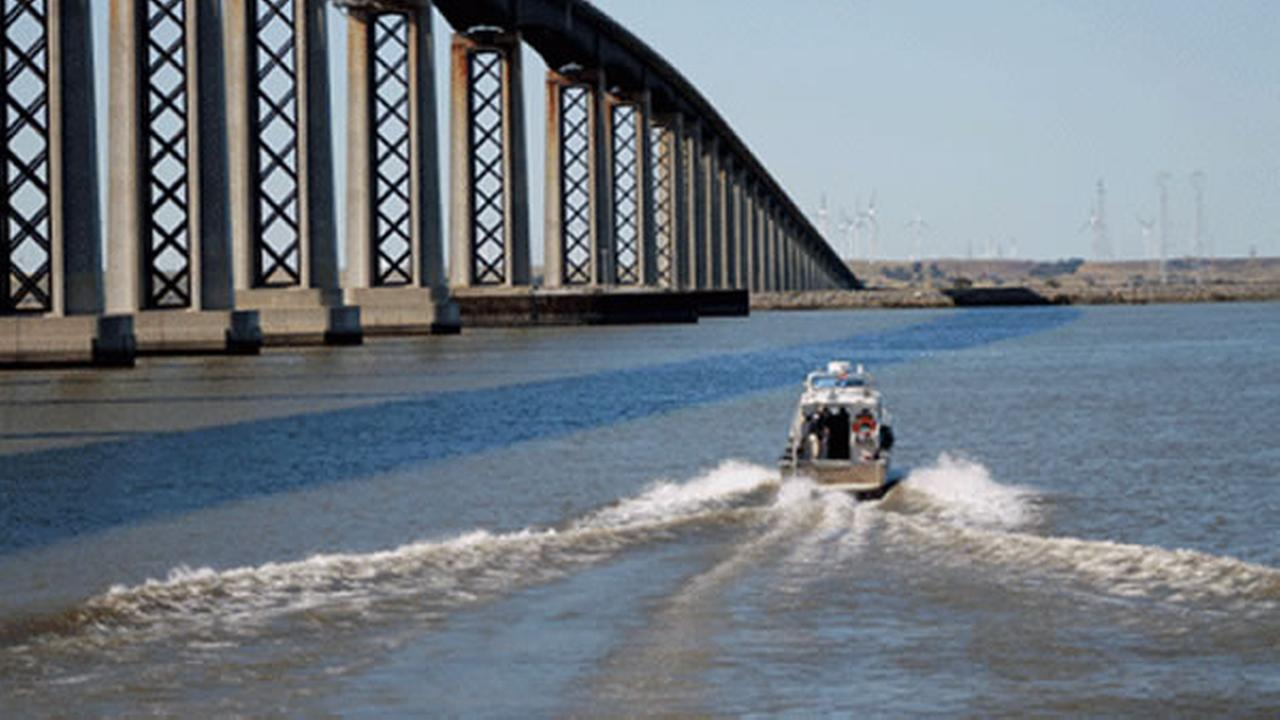 Crews search for a motorcyclist who was thrown into the San Joaquin River after colliding with a car on the Antioch Bridge in Antioch, Calif. on April 12, 2015.