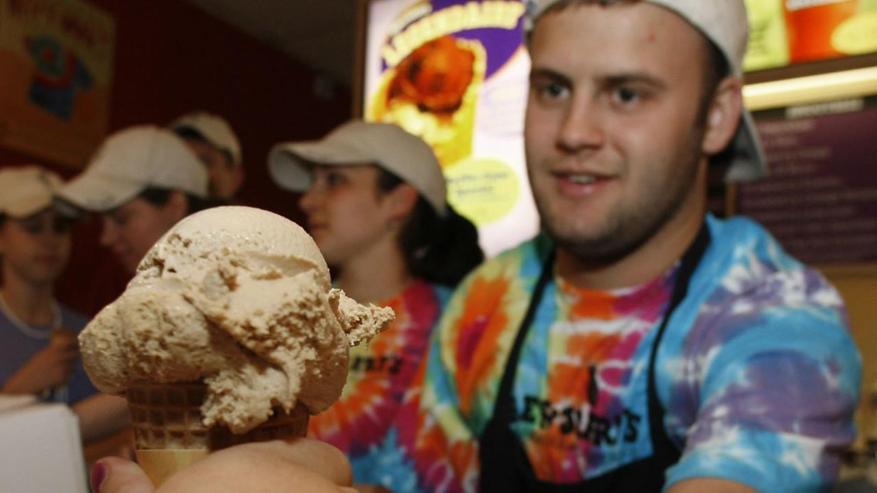 Aleck Woodmaster serves up a free ice cream cone at the Ben and Jerrys shop in Montpelier, Vt., Tuesday, April 25, 2006. (AP Photo/Toby Talbot)