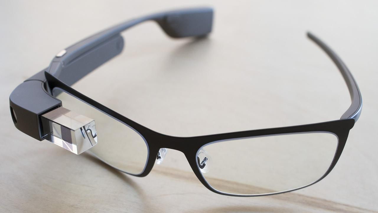 The new Google Glass Bold prescription frames rest on a table at the Google Glass Basecamp space at Chelsea Market, Jan. 24, 2014, in New York. (AP Photo/John Minchillo)