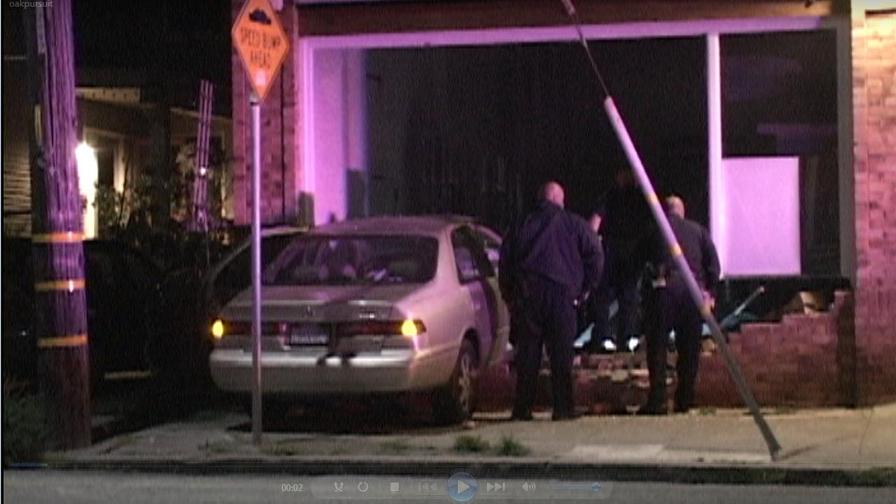 A car slammed into a building in Oakland on 41st Street on Thursday.
