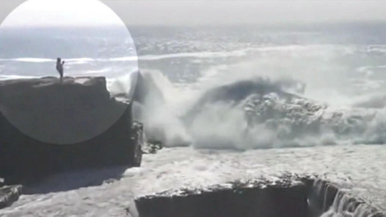 This stunning image captured the moment before a woman was swept off a cliff by a massive wave while on vacation in Ireland.