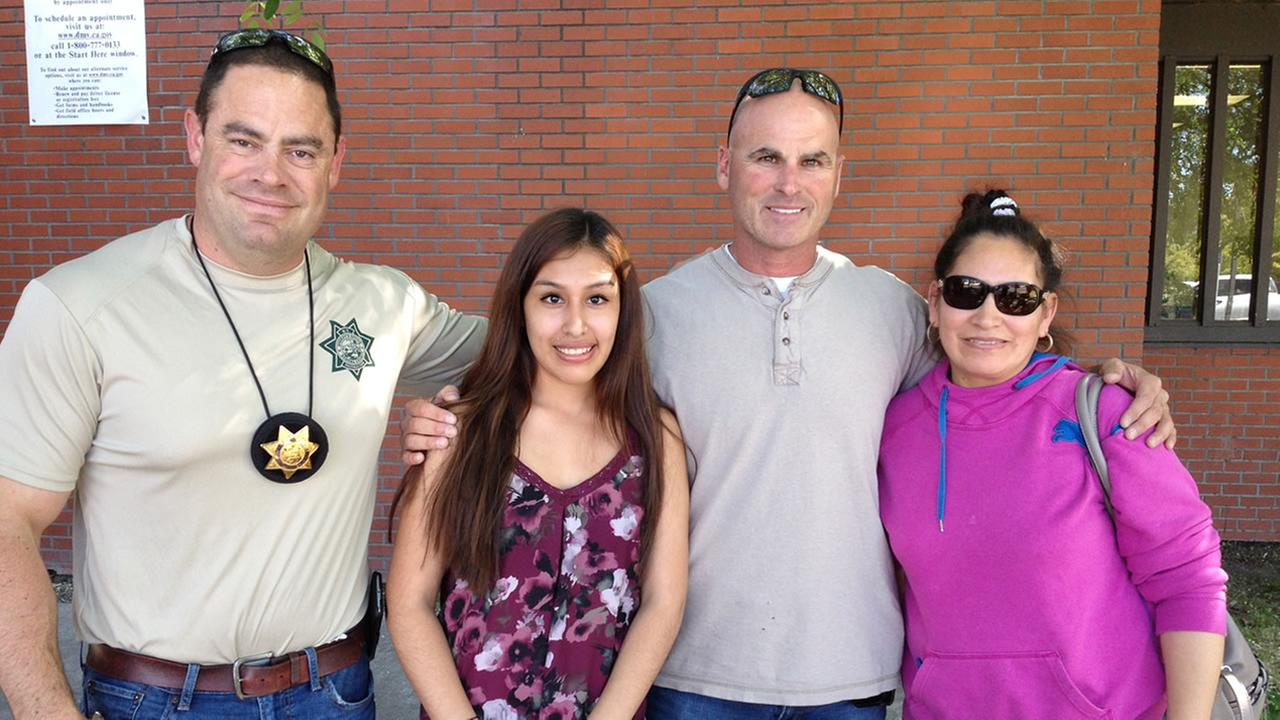 Sonoma County Deputy Sheriffs Association president Joe Dulworth, Julisa Sanchez, Sgt. Mike Raasch Julisas mother pose together after they helped send Sanchez to prom.