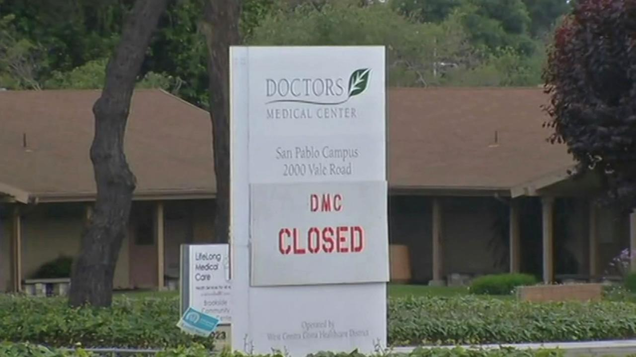 A sign posted outside Doctors Medical Center in San Pablo, Calif. announces the hospitals closure on April 21, 2015.