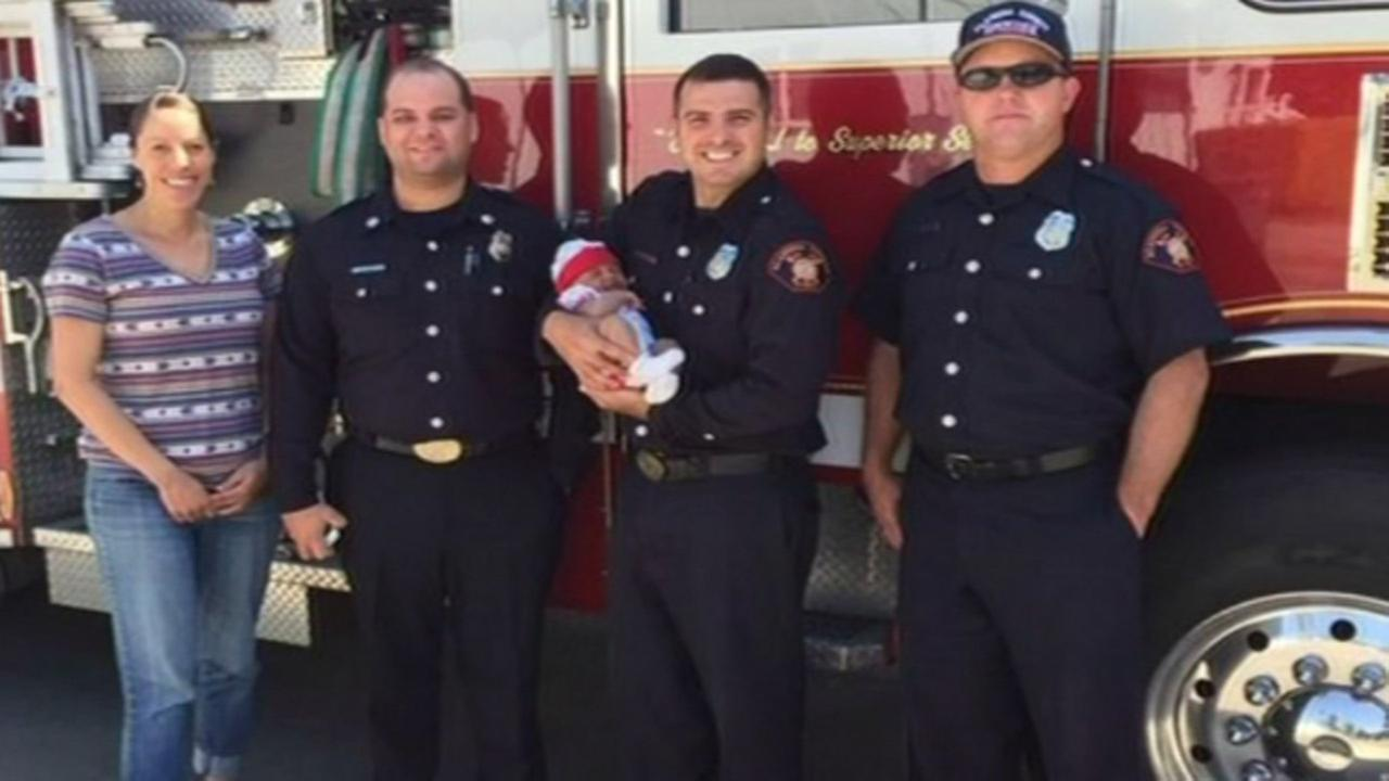 Baby Eva and mom with firefighters who helped deliver her in San Leandro.