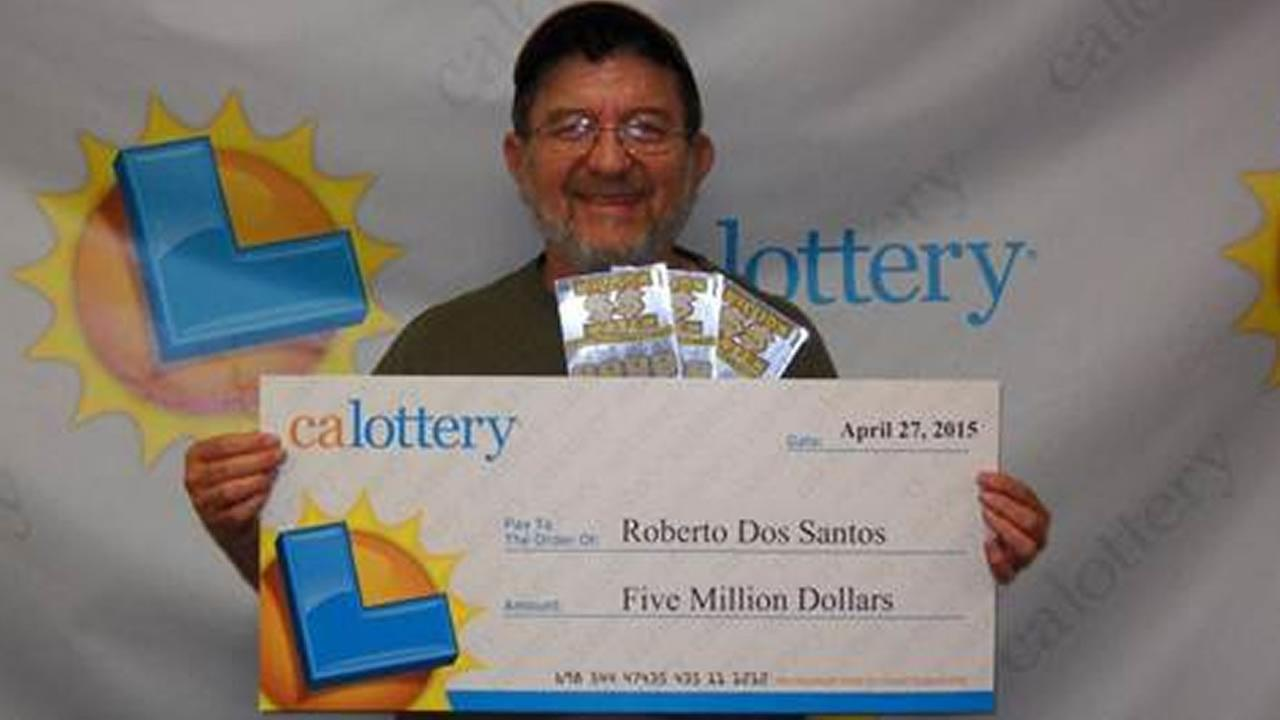 Robert Dos Santos of Berkeley, Calif. poses with his check for $5 million after he won the lottery for the second time in two months, April 28, 2015.