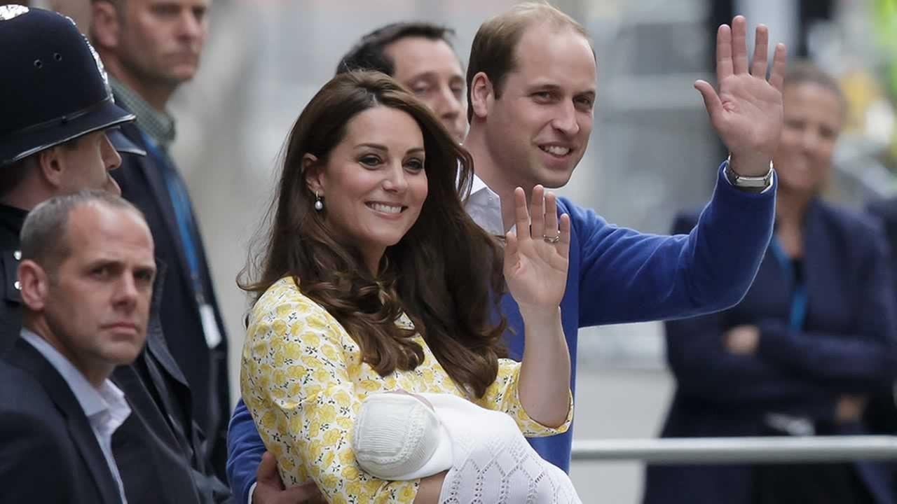 Britains Prince William and Kate, Duchess of Cambridge and their newborn baby princess, wave to the public in London, Saturday, May 2, 2015.
