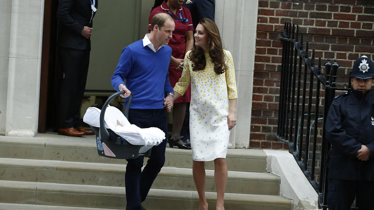 Britains Prince William, left, and Kate, Duchess of Cambridge, hold their newborn daughter as they as they leave St. Marys Hospital in London on Saturday, May 2, 2015.