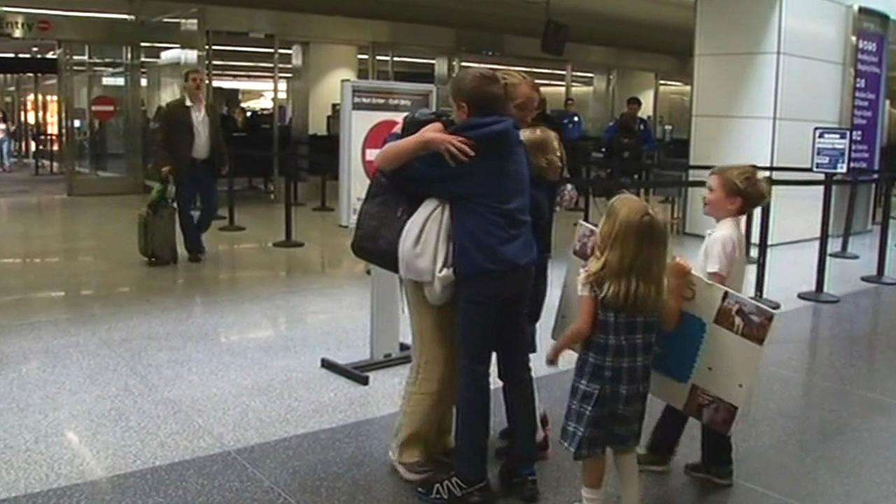 Siobhan McFeeney hugs her children at San Francisco International Airport on May 4, 2015 after returning home safely following the devastating Nepal earthquake.