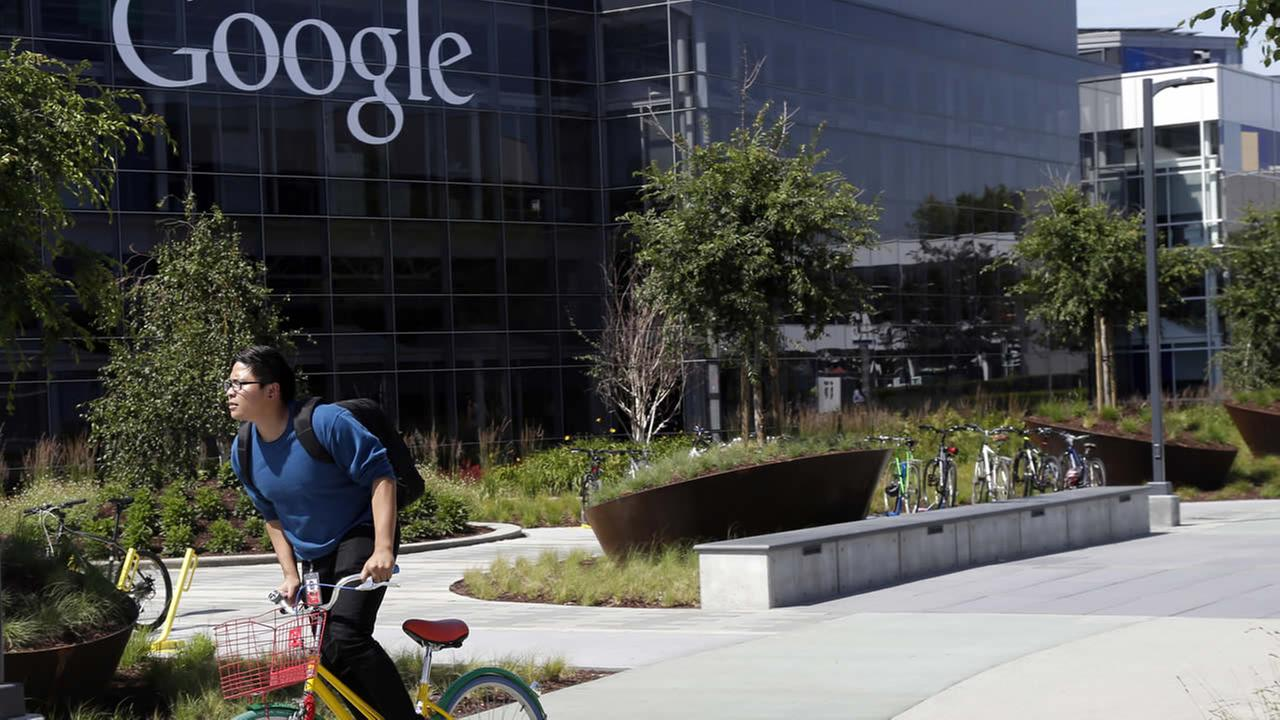 FILE: In this June 5, 2014 file photo, a worker rides a bike on Googles campus in Mountain View, Calif. (AP Photo/Marcio Jose Sanchez)