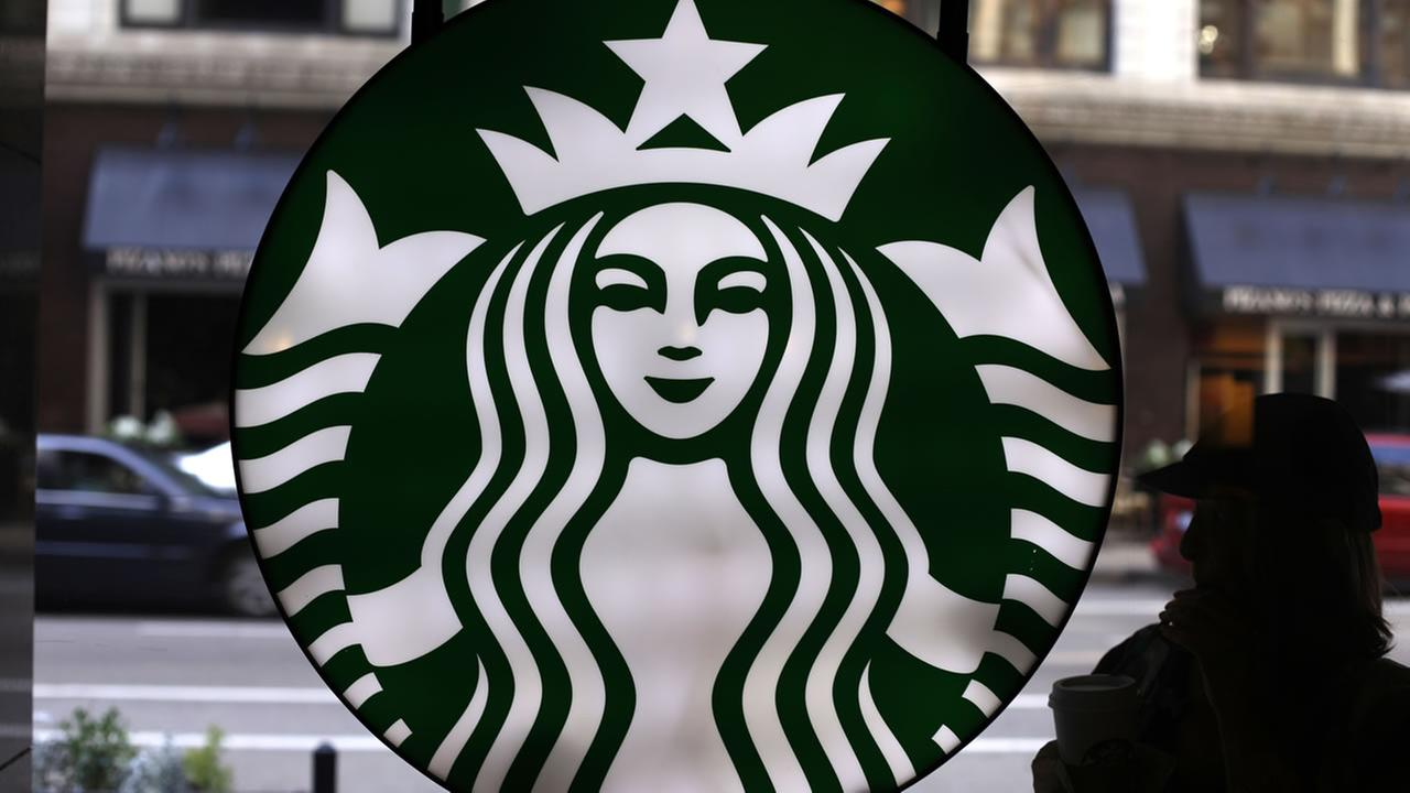In this Saturday, May 31, 2014, file photo, the Starbucks logo is seen at one of the companys coffee shops in downtown Chicago.