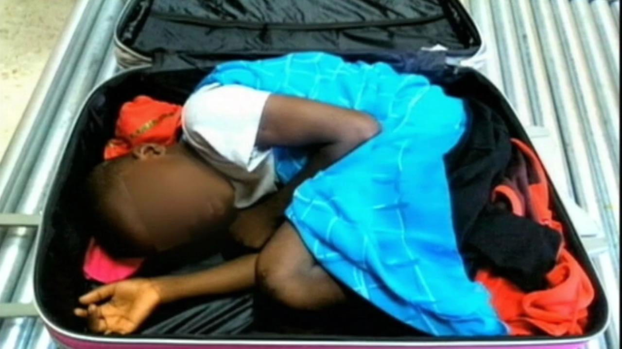This photo shows an 8-year-old boy after he was found inside of a suitcase at an airport in Spain.
