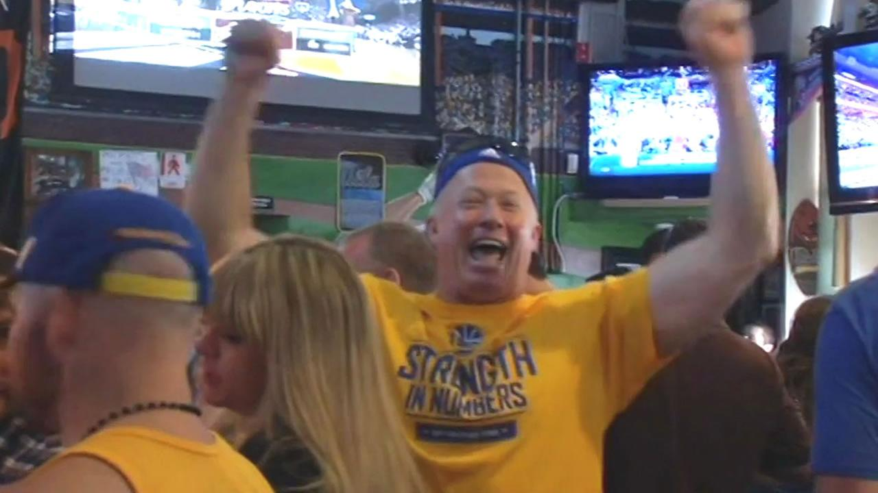 A Golden State Warriors fan cheers on his team at a bar in Walnut Creek, Calif. on May 10, 2015.