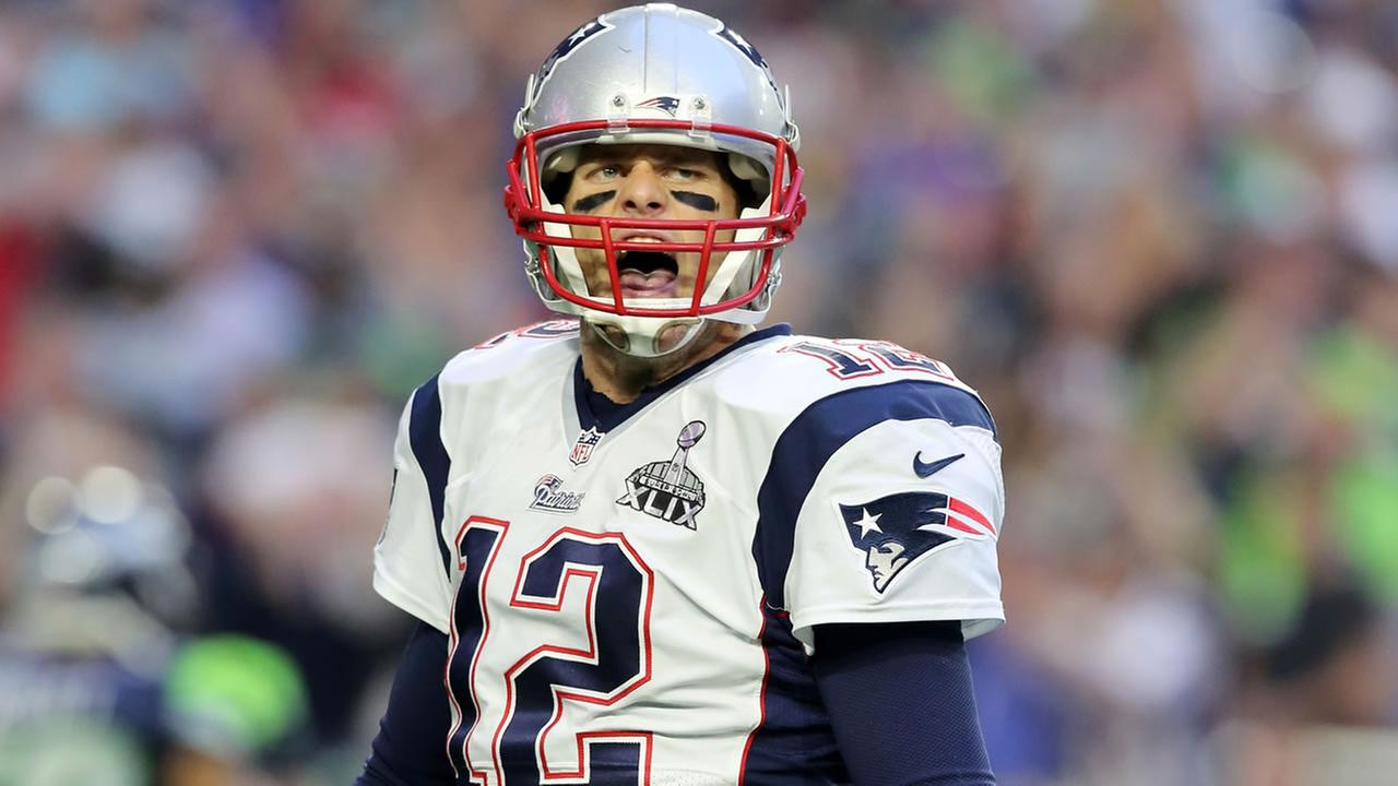 New England Patriots Tom Brady #12 celebrates a touchdown pass against the Seattle Seahawks during the Super Bowl on Sunday, February 1, 2015 in Glendale, AZ. (AP Photo/Gregory Payan)