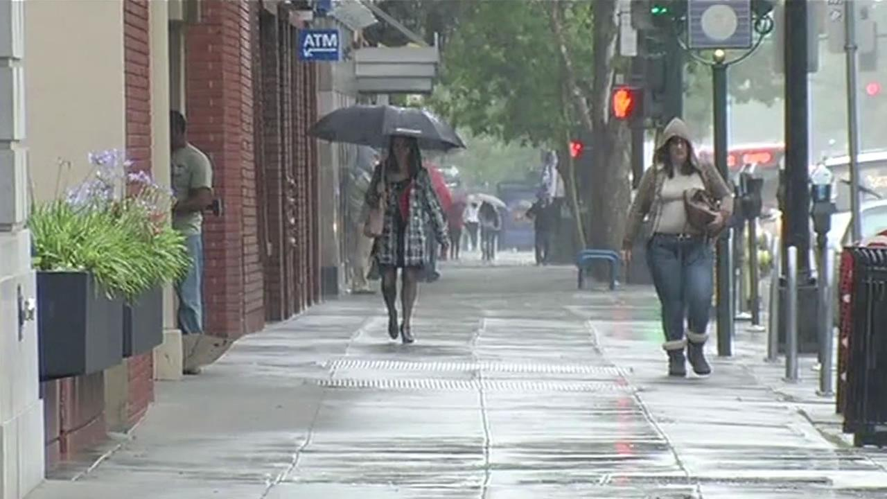 Two women walk through the rain in the South Bay May 14, 2015.