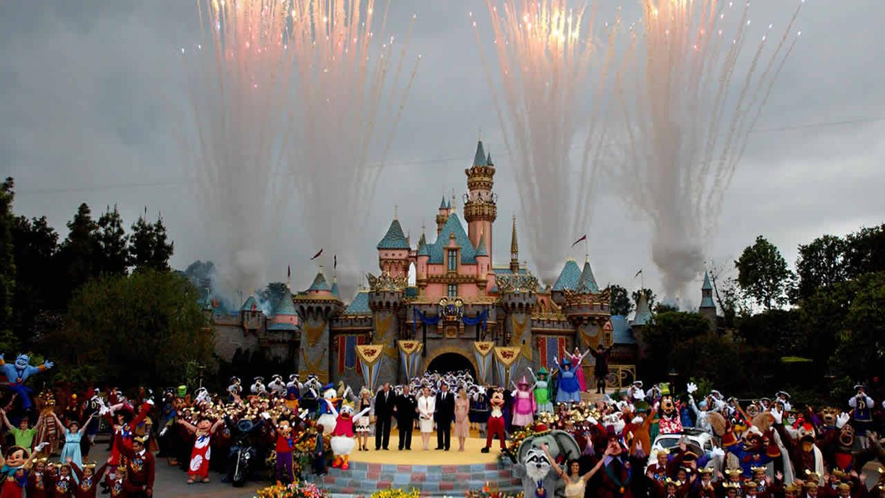 Disney Executives, characters and guests stand in front of the refurbished Castle during Disneys 50th Anniversary Global Celebration Event at Disneyland in Anaheim, May 5, 2005. (AP Photo/Ann Johansson)