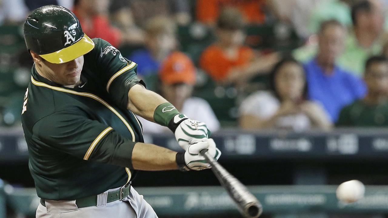 Oakland Athletics Josh Phegley connects to load the bases with a single to left field against the Houston Astros in the fourth inning of a baseball game Wednesday, May 20, 2015.