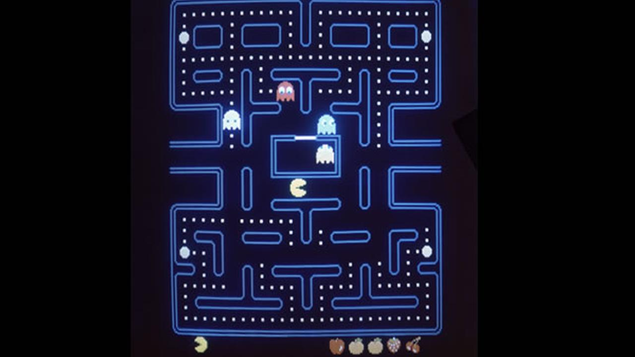 This close up view of a monitor shows the electronic video game Pac-Man in 1983.