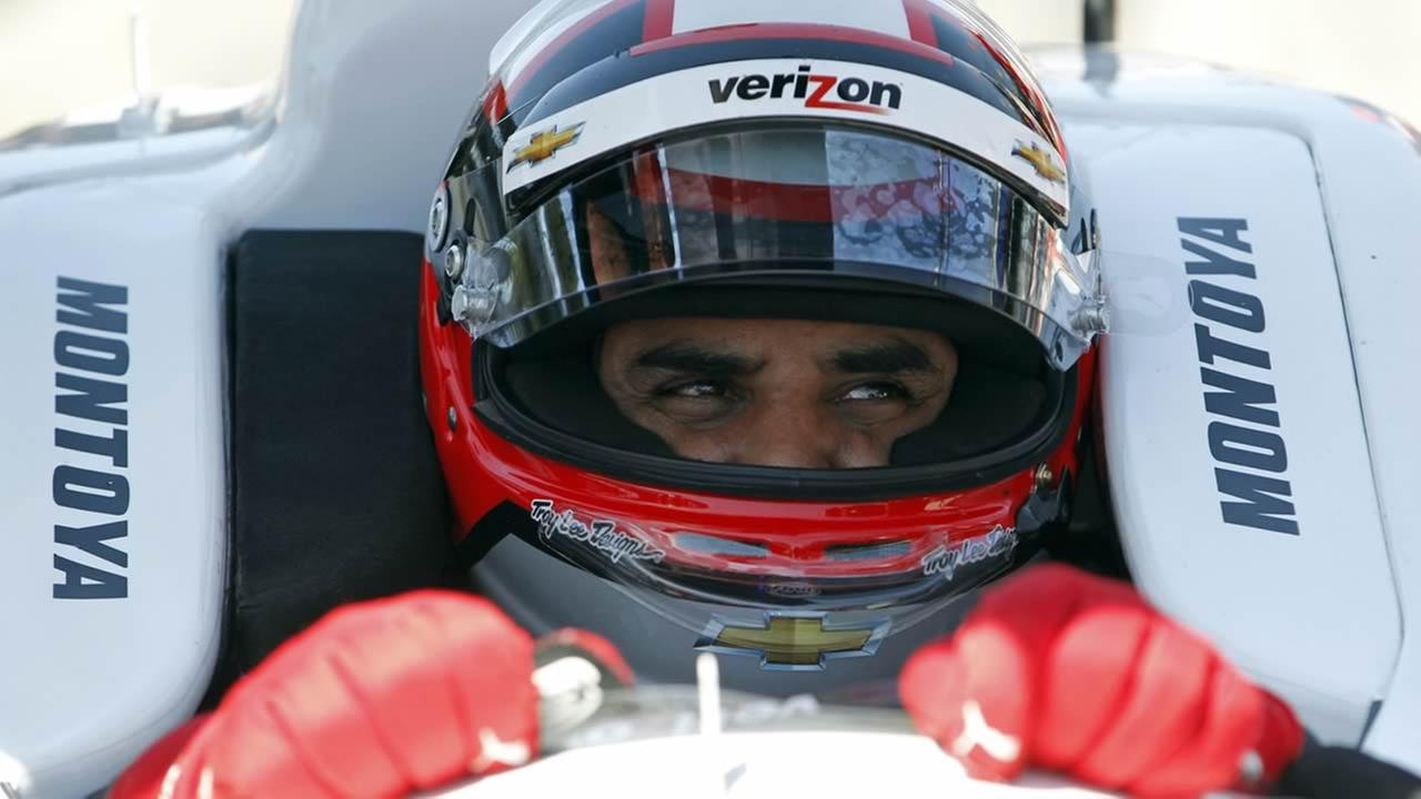 Juan Pablo Montoya, of Colombia, sits in his car during practice for the Indianapolis 500 auto race at Indianapolis Motor Speedway in Indianapolis, May 13, 2015. (AP Photo/AJ Mast)