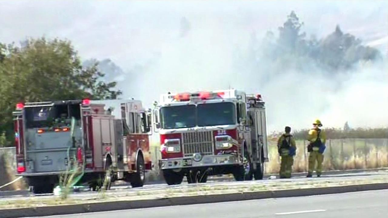 Crews battle a brush fire burning in a field near Eastridge Mall in San Jose on Sunday, May 24, 2015.