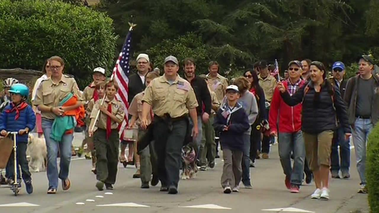 Boy scouts march during a Memorial Day parade in Mill Valley, Calif. on May 25, 2015.