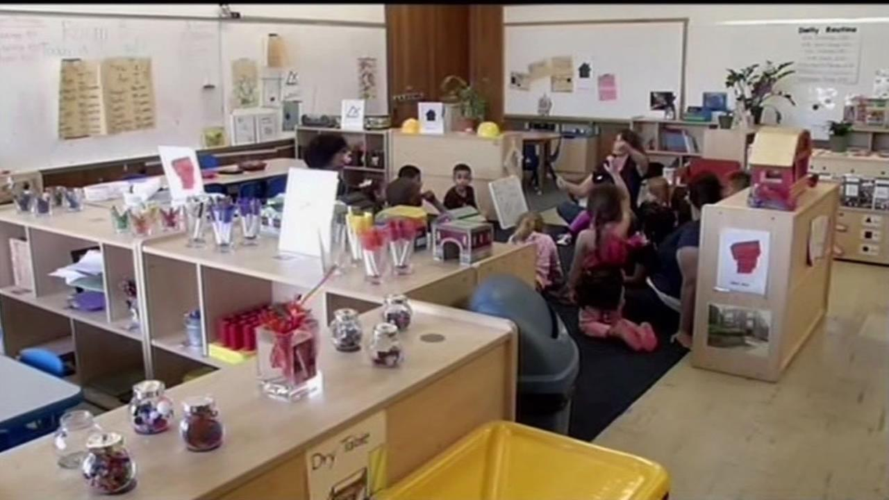Children at Kids Club preschool in Antioch listen to their preschool teacher May 26, 2015.