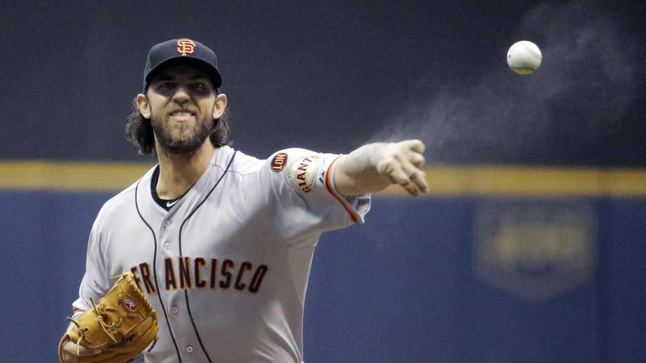 San Francisco Giants starting pitcher Madison Bumgarner throws before the first inning of a baseball game against the Milwaukee Brewers Tuesday, May 26, 2015, in Milwaukee.
