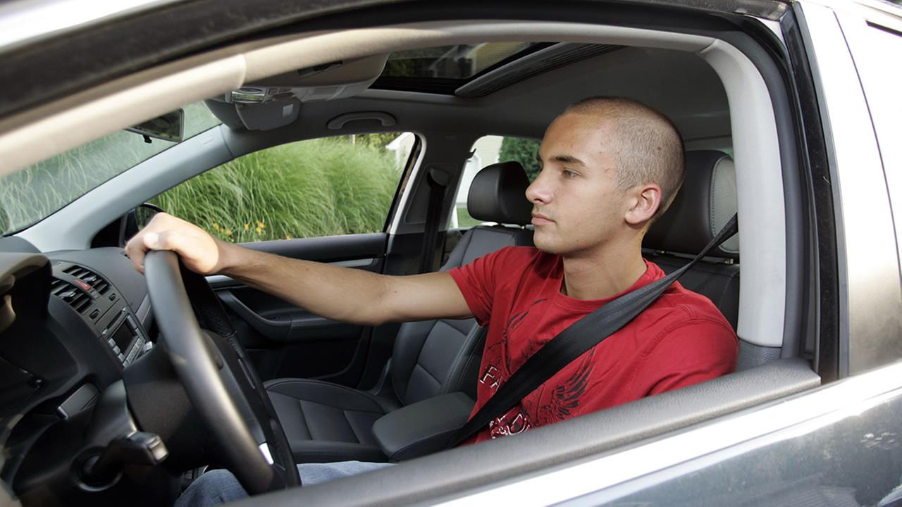 Richard Meehan, 16, is seen with his car at his home in Shelton, Conn.