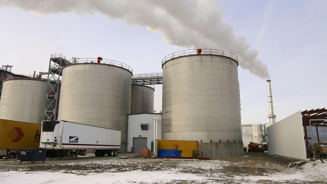 FILE - In this Jan. 6, 2015 file photo, steam blows over fermentation tanks at the Green Plains ethanol plant in Shenandoah, Iowa.