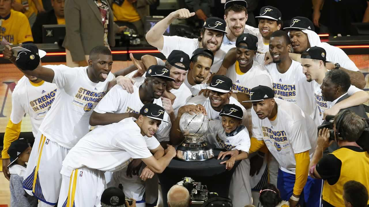 Golden State Warriors players celebrate after Game 5 of the NBA basketball Western Conference finals against the Houston Rockets in Oakland, Calif., Wednesday, May 27, 2015.