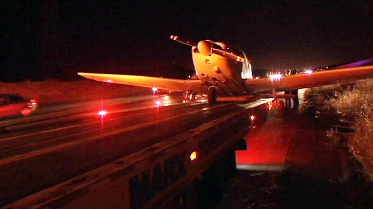 A plane made an emergency landing on a road near Highway 101 in Morgan Hill, Saturday, June 6, 2015.