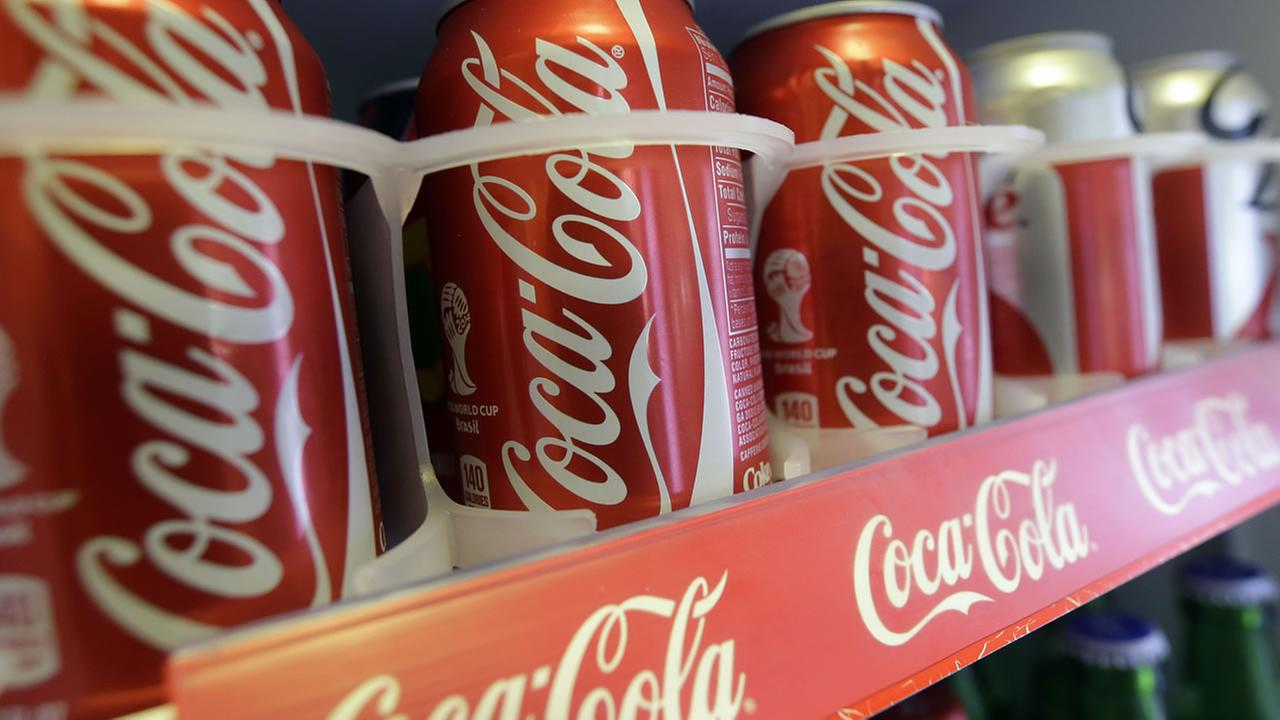 In this June 30, 2014 photo cans of Coca-Cola soda pop are shown in the refrigerator inside of Chile Lindo in San Francisco. (AP Photo/Jeff Chiu)