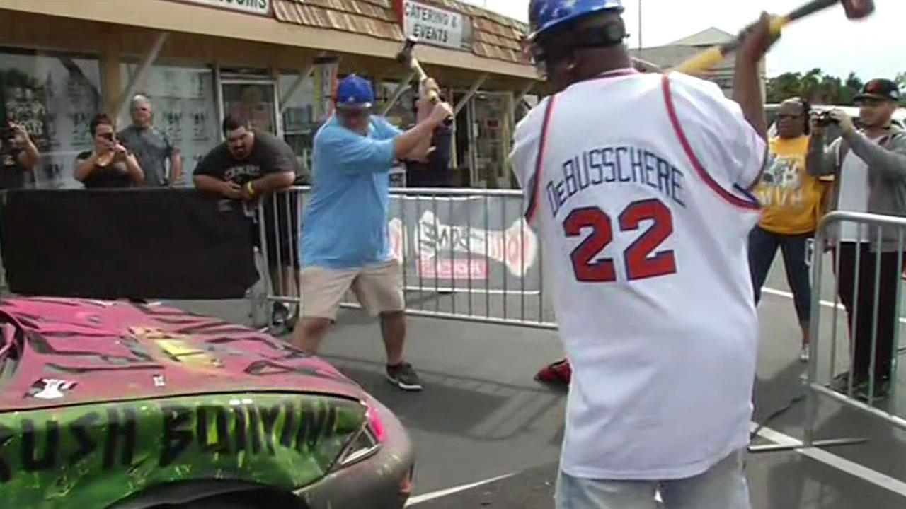 Warriors fans got the chance to smash a Chevy Cavalier as part of a pre-NBA Finals game fundraiser at Rickeys Sports Theatre in San Leandro, June 9, 2015.