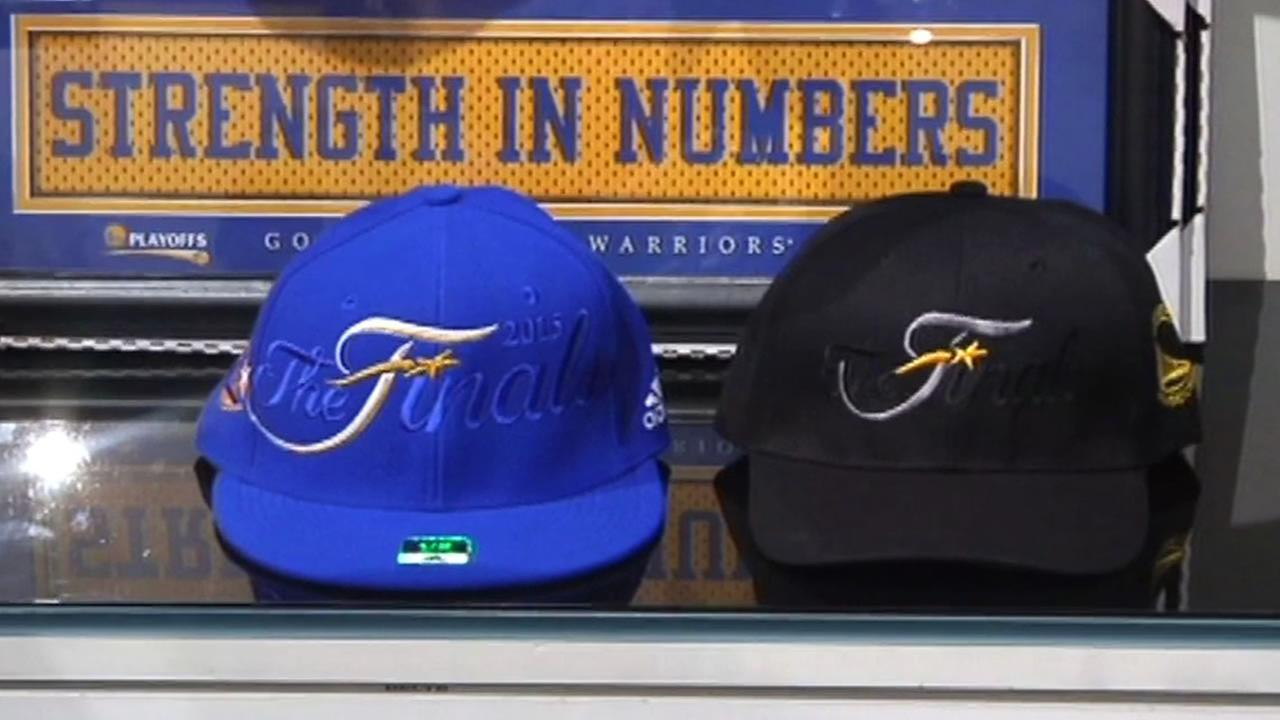 A real NBA hat sits next to a counterfeit one