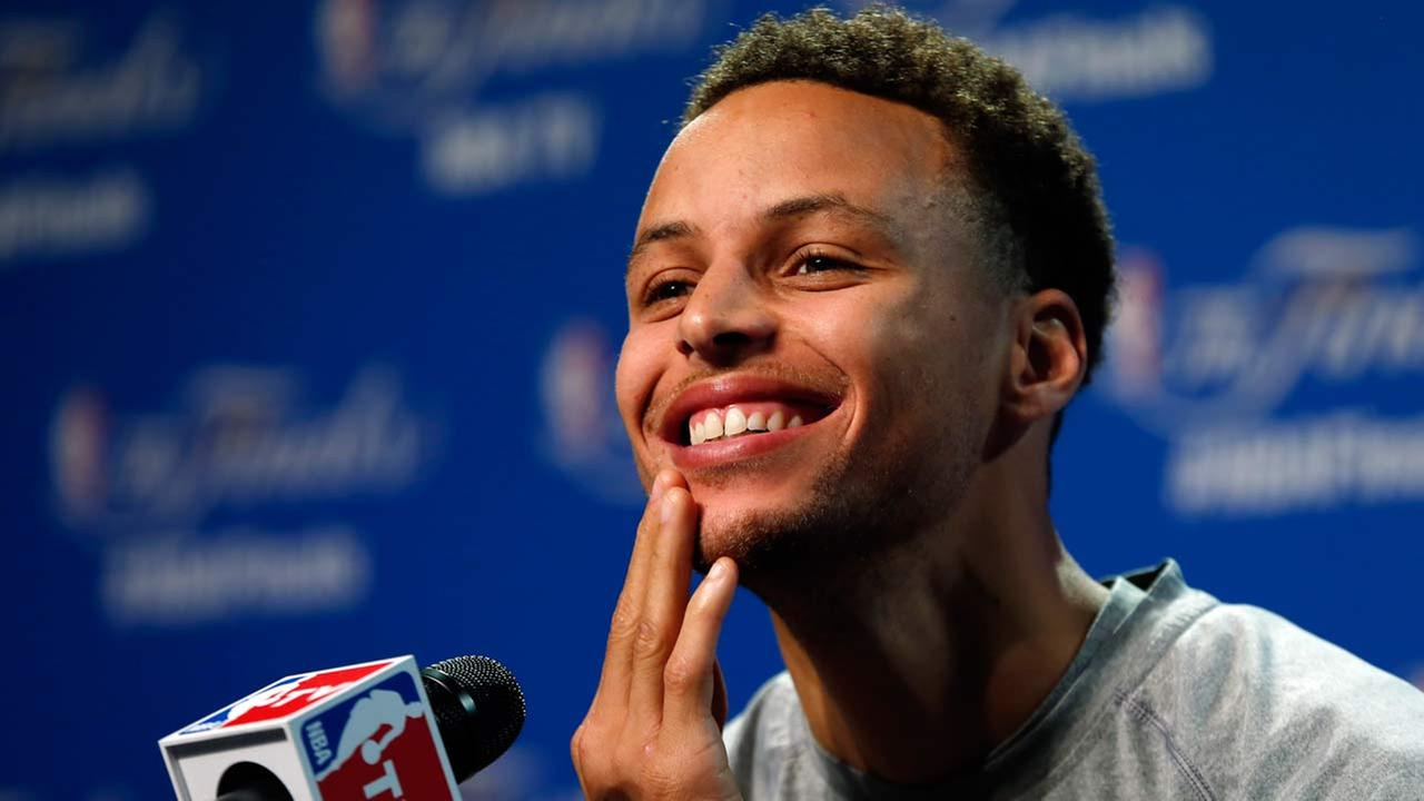 Golden State Warriors guard Stephen Curry answers a question during press conference for basketballs NBA Finals in Cleveland, Wednesday, June 10, 2015.