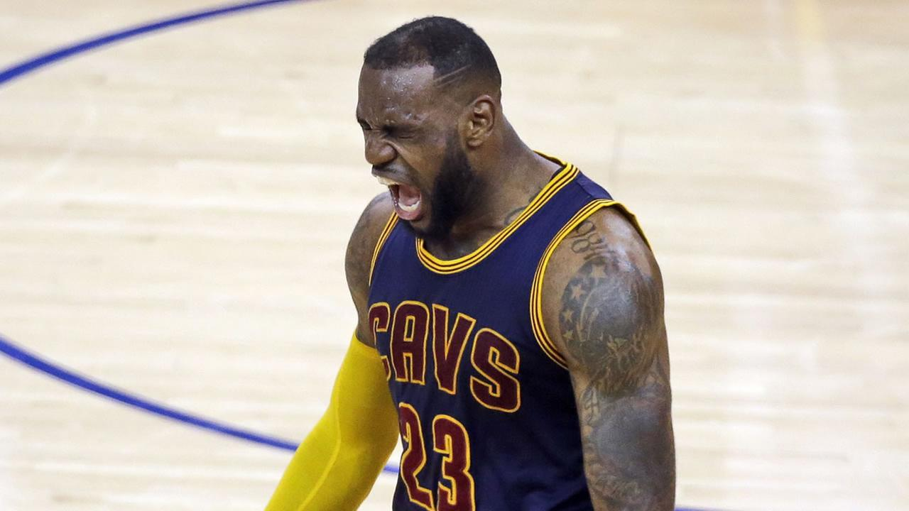 Cavaliers forward LeBron James celebrates at the end of the overtime period of Game 2 of the NBA Finals against the Golden State Warriors in Oakland, Calif., June 7, 2015. (AP Photo/Eric Risberg)