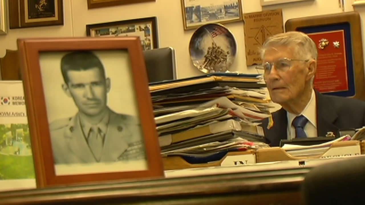 United States Marine Corps retired Lt. Col. John Stevens sits at his desk