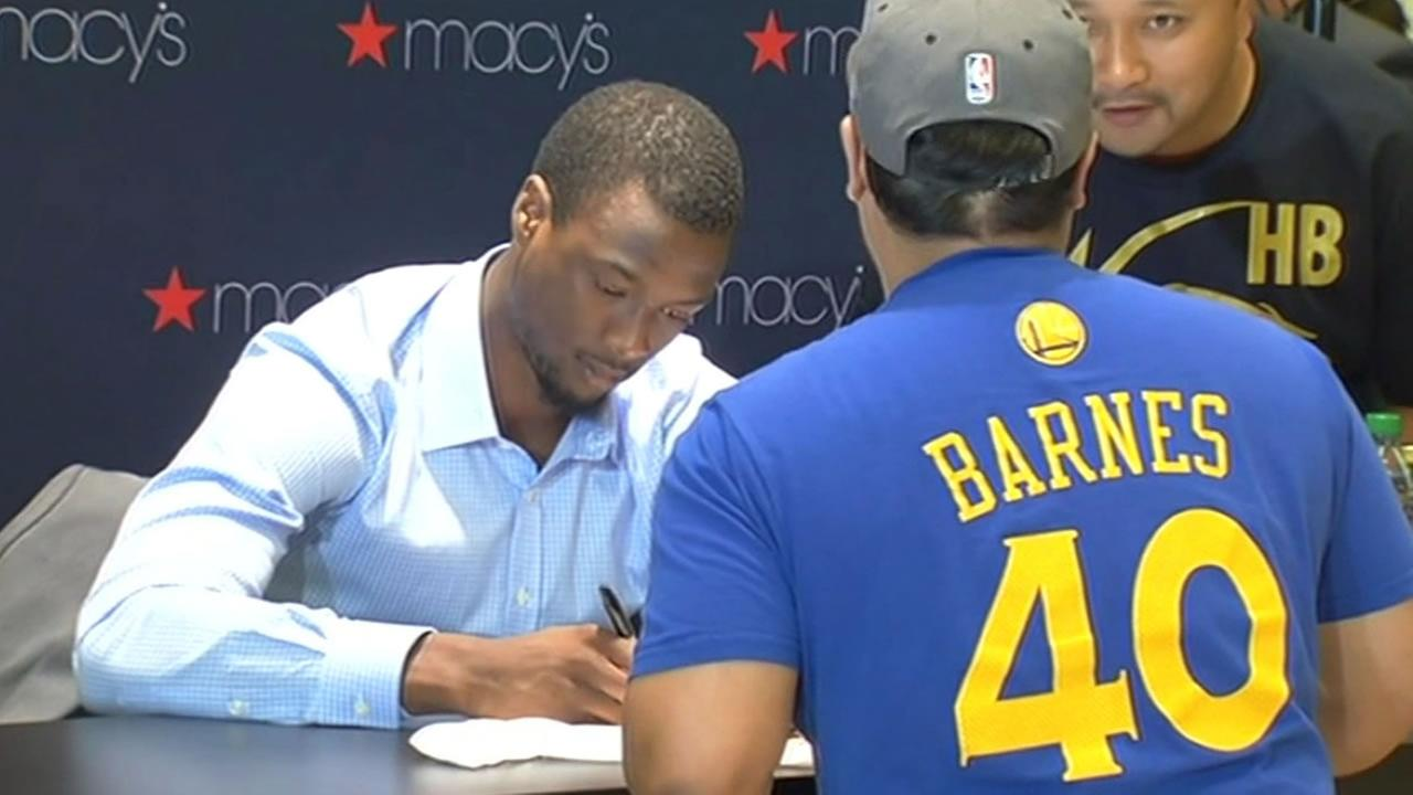 This week several Warriors players will be in Burlingame at Leftys Sports to sign autographs for fans. Here Harrison Barnes signs an autograph for a fan.