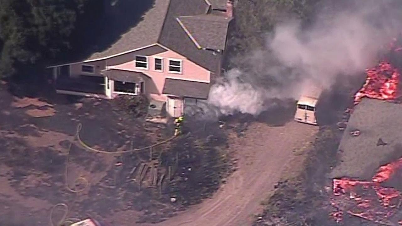 home burning and barn on fire in Livermore