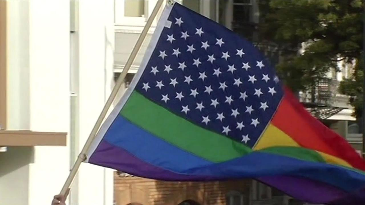 A Pride flag is waved in San Francisco on Friday, June 26, 2015 following the Supreme Courts same-sex marriage ruling.