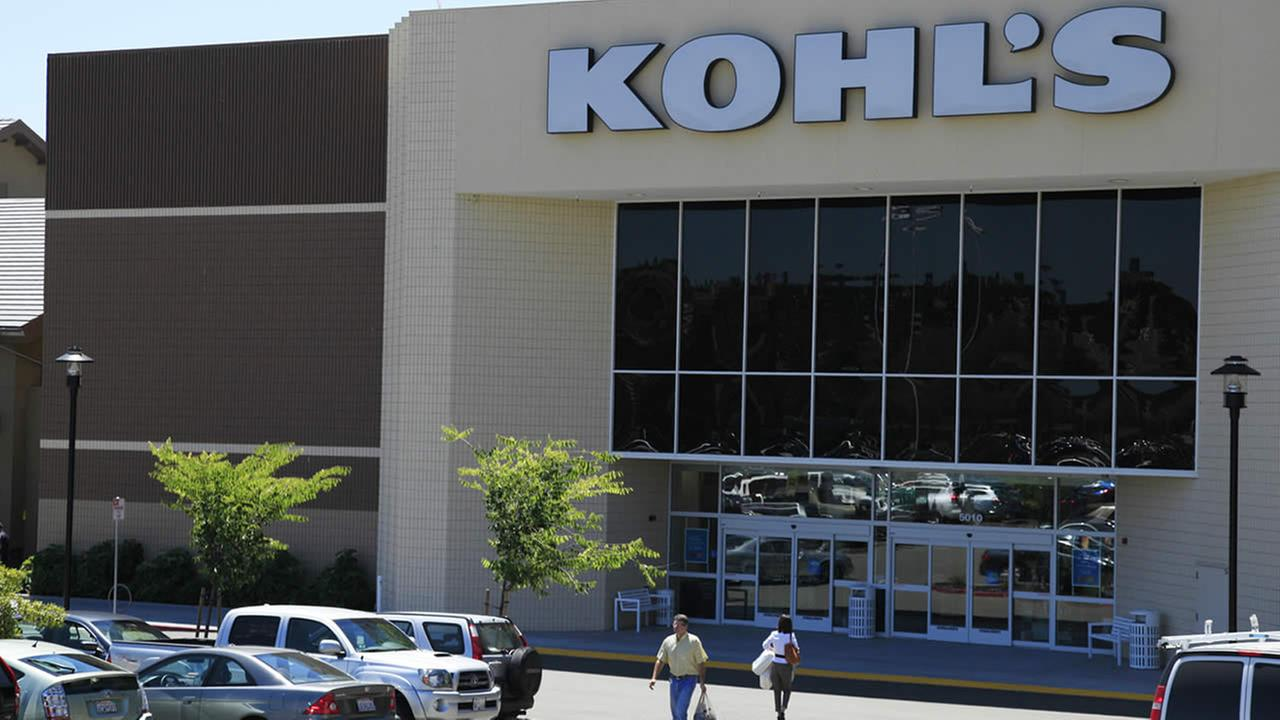 In this Aug. 8, 2011 photo, shoppers enter and exit the Kohls store in San Rafael, Calif. (AP Photo/Eric Risberg)