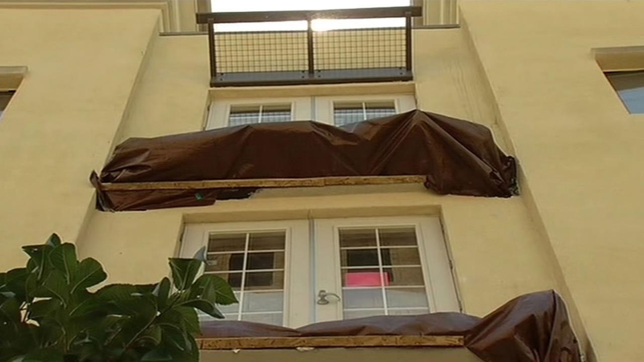 Crews examine a balcony that collapsed at the Library Gardens apartment complex in Berkeley that killed six people and injured seven, June 30, 2015.