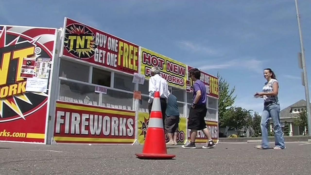 Customers stand in line at a firework stand in Petaluma that opened Tuesday, June 30, 2015.