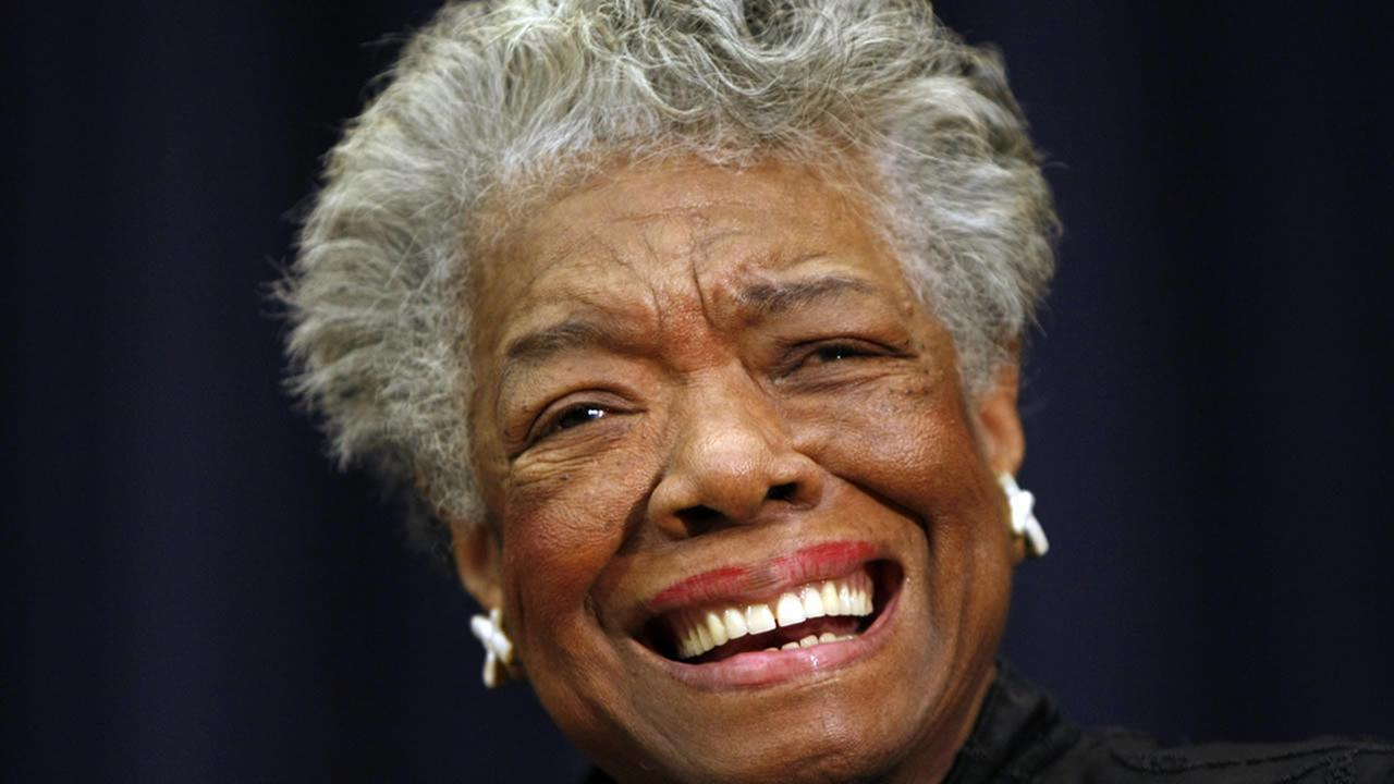 In this Nov. 21, 2008 file photo, poet Maya Angelou smiles at an event in Washington. (AP Photo/Gerald Herbert, File)