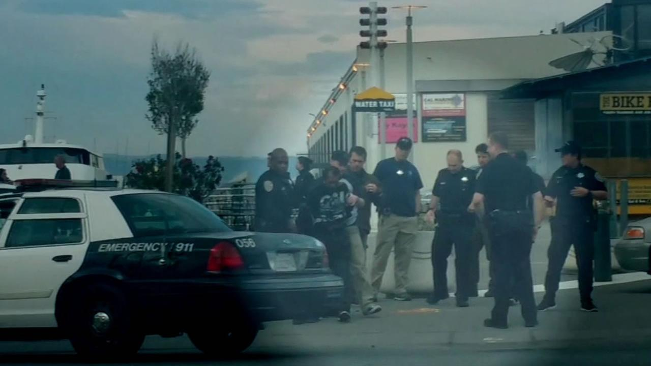 This still image is from video obtained by ABC7 News showing the arrest of the man accused of killing a woman on Pier 14 in San Francisco on Wednesday, July 1, 2015.