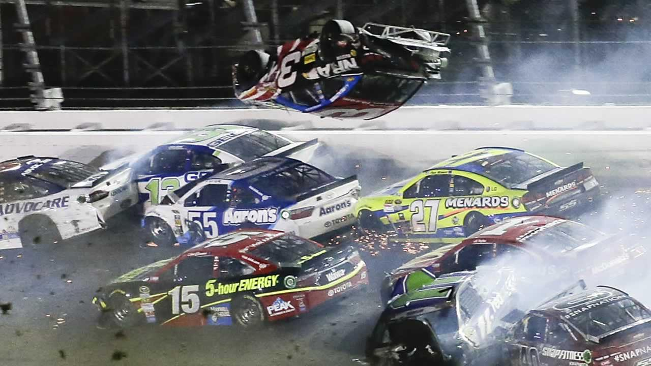 Austin Dillon goes airborne and hits the catch fence on the final lap of the NASCAR Sprint Cup series at Daytona International Speedway, Monday, July 6, 2015 in Daytona Beach, Fla.