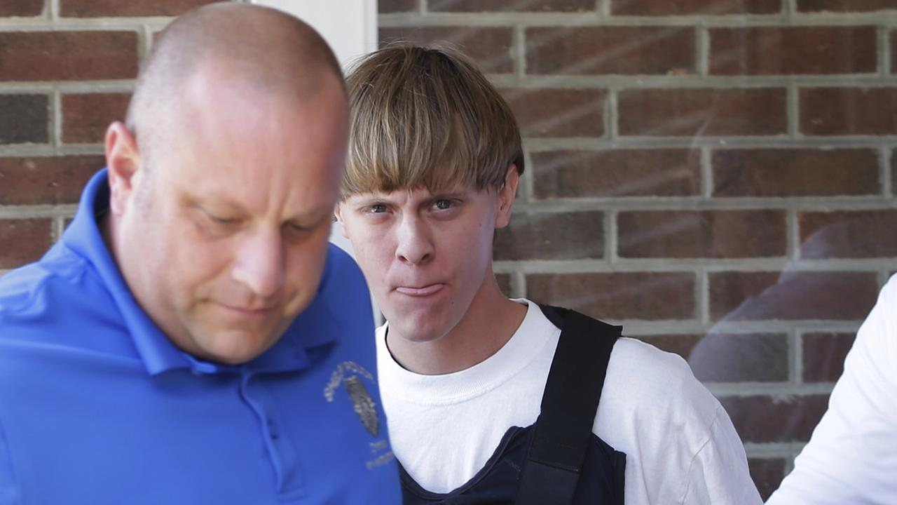 In this June 18, 2015 file photo, Charleston, S.C., shooting suspect Dylann Storm Roof, center, is escorted from the Sheby Police Department in Shelby, N.C.