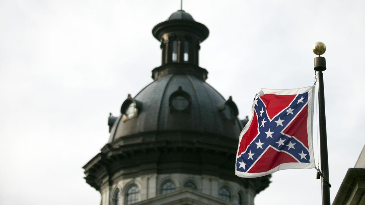 A Confederate battle flag flies in front of the South Carolina statehouse Wednesday, July 8, 2015, in Columbia, S.C.