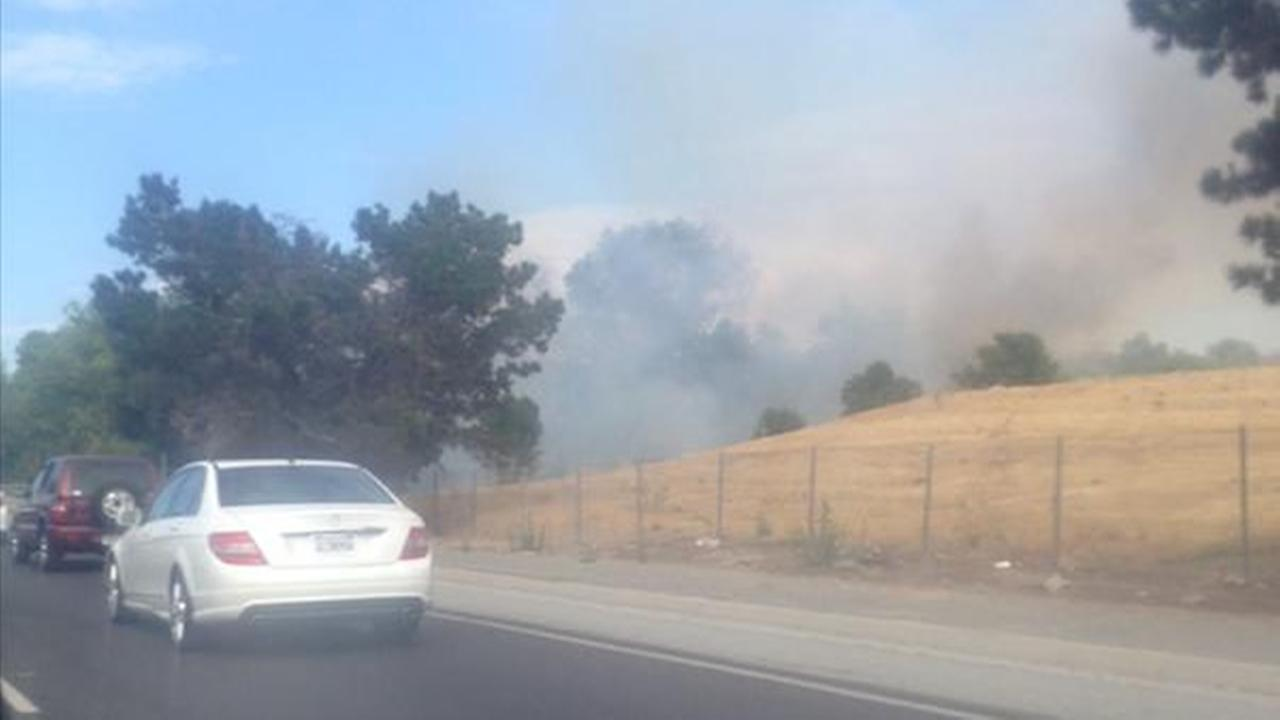 Crews battled a brush fire at Tuers Road and the East Capitol Expressway in San Jose on Friday, July 10, 2015.