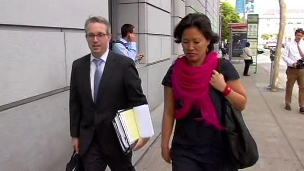attorney Peter Skinner, client Mimi Lee walking outside court